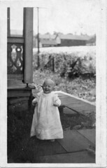 Baby in dress on board walkway (Meyersdale Public Library) Tags: people babies 1910s infants 1900s porches photobox2 mccunealbum