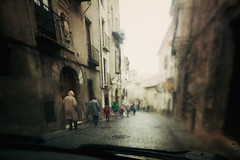 Bad Rains (Sator Arepo) Tags: street espaa wet car rain canon spain driving overcast down rainy 5d 24mm raincoat windscreen ts cuenca tse markii tiltshift pavestones