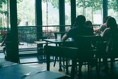 Looking Out (eekiem) Tags: coffee snacks latte troika olympusom10 kualalumpu kodakcolorplus200 acmebarcoffee