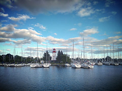 IMG_20130902_084421-1 (416Pictures) Tags: cameraphone park sky lighthouse lake toronto ontario west clouds marina boats bay waterfront cellphone shore promenade android humber