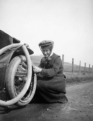 A woman changing a tyre on a steam car in 1906 (RCAHMS) Tags: bw woman hat car rural scotland countryside automobile veil album churches steam vehicle oldphoto 1906 canmore commission westernisles innertube edwardian tyre historicphoto steamcar lostscotland unitedfreechurch s302 rcahms sc1105238