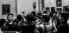 La star du louvre/The star of the louvre. (m-g-c photographie) Tags: portrait blackandwhite bw white black paris france art heritage tourism monument museum painting de landscape la fan photo europe italia noir photographie noiretblanc louvre famous ngc culture lisa mona tourist muse nb souvenir memory mgc leonard tableau paysage vinci et blanc lonard italie lelouvre joconde tourisme patrimoine peintre thelouvre leonardodavinci touriste lajoconde lonarddevinci themonalisa clbre lastardulouvre thestarofthelouvre