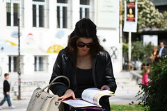just a glimpse (Kostas Gourgiotis (Cost@s)) Tags: street people girl canon reading book just costs glimpse 28135is kostas 450d gourgiotis kgour