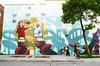 Rock, Paper, Scissors (Georgie_grrl) Tags: family streetart tree bicycle skull graffiti mural god quebec montreal puppets pedestrians pentaxk1000 devil rockpaperscissors hiding showdown cufflinks rikenon12828mm thegreatcrepeescape rooooooadtrip muralfestival2015 alexscanerofcanada