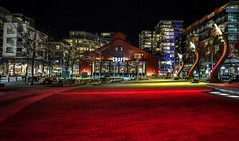 Roll out the red carpet  (2010 Olympic Village Plaza) (Christie : Colour & Light Collection) Tags: nightphotography olympicplaza 2010olympicvillage olympics olympic cityofvancouver vancouver bc canada falsecreek red boldcolour intensecolour photography night beermarket restaurant skyline skyscape nightlighting nightlights evening illuminate cobblestone condos apartments streetphotography