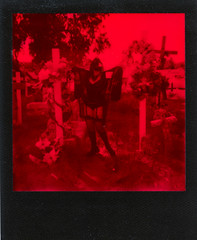 SPD_Polaroids-7 (MrAnathema) Tags: plaguedoctor cemetary black red impossibleproject impossible onestep monochrome impossiblemonochrom crosses girl plague doctor goth gothic graveyard arizona polaroid polaroidpicture instantfilm instantphotograph instantpicture blackframe
