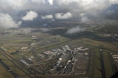 View of an airfield (Vee living life to the full) Tags: sky cloud clouds blue storm rain rainbow colours amsterdam netherlands holland amstel canal river boat ship cargo tanker bridge land helicopterview birdseyeview distance marine marina fields patchwork airfield airport aeroplane carriers planes transport people network water treatment works landscape picture porthole view nikond300 2016 november holiday weekend travel tourism tourist placestovisit traveller pleasure flying flight