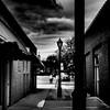 Carpe Lumen (Kozma Shots) Tags: summer dark alley arcade shoppingarcade walkway monocrome blackandwhite composition art myart artistic contrast highcontrast clouds sky wind sil shadow d7100 nikon nikkor nikond7100 35mm leisure shootall breeze monochromemondays monochromemonday noir noiretblanc outside bw
