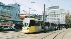 UK - Manchester tram (onewayticket) Tags: tram transport urban metrolink bombardier m5000 bombardierm5000 film zenit 12xp zenit12xp sirius sirius2828 canoscan9000f