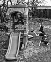Trick gone awry (Pejasar) Tags: boy grandson play swing fall yard blackwhite bw playground slide