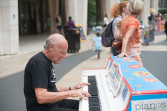 A Man Playing Sing for Hope Piano at Lincoln Center (Shawn Hoke) Tags: plaza nyc center lincoln lincolncenterplaza nikond700 singforhope sfhpianos singforhopepianos