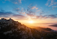 Gordes Sunrise (Philipp Klinger Photography) Tags: morning blue sky orange cloud sun mountain france castle church nature yellow fog architecture clouds sunrise landscape town frankreich warm village hill hills provence luberon gordes