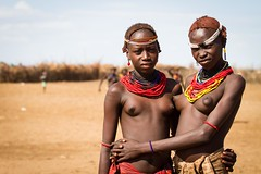 Accessorized (Universal Stopping Point) Tags: girls pose nude necklace women hug tribal topless omovalley ethiopia tribe embrace arid headband traditonal omorate omoriver dassanech