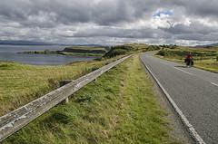 Ilze riding along the coast of Skye Island (TheCrazyTravel.com) Tags: road sea skye clouds coast scotland escocia september bycicle reinounido biketouring ilze