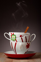 Steaming Cinnamon Tea (tltichy) Tags: china red stilllife white hot cup coffee studio table three tea cinnamon gray january tasty plate stack steam cups ceylon pure inviting warming steaming oneeye 2014 mikasa alienbees