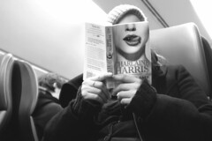 Reading Head (d_t_vos) Tags: portrait bw woman tongue mouth reading book head traveller traincar harris charlaine facesofportraits dickvos dtvos