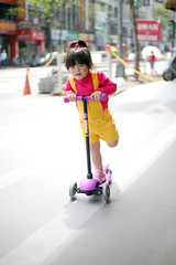 Zorie slides like winds. (Zorie Huang) Tags: morning pink light portrait baby sunlight cute girl yellow naughty asian kid infant child innocent taiwan scooter snap nike 5d canon5d lovely glider taiwanese overall twoyearold streetsnap nikesneakers zorie