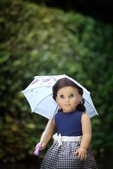 Gypsie in the Rain (5hens) Tags: summer rain marie umbrella 50mm grace rainy american gypsie americangirl americangirldoll 5hens 5hensandahowardbird 5hensandacockatiel