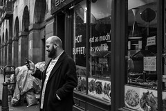 Hot Buffet (Silver Machine) Tags: london chinatown streetphotography street streetportrait candid phone standing shop shopwindow man beard outdoor blackwhite bw mono monochrome fujifilm fujifilmxt10 fujinonxf35mmf2rwr
