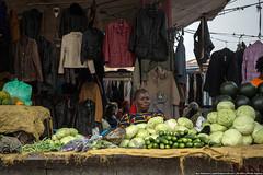 Leather jackets & green vegetables, Kinshasa (varlamov) Tags: africa vegetables market clothes seller drc kinshasa democraticrepublicofthecongo