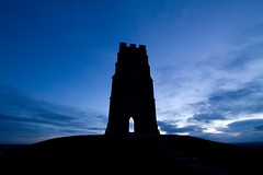 Glastonbury Tor at dawn (Mukumbura) Tags: christmas uk travel blue winter england sky green grass festival dawn scenery unitedkingdom britain thistle hill glastonbury somerset summit destination gettyimages glastonburytor welcomeuk