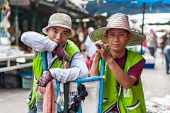 Taking a rest (Willfrolic) Tags: portrait green thailand colorful market bangkok hats fresh rest taking carrier klong toey klongtoey