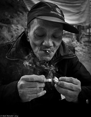 Desperate for a smoke. (Neil. Moralee) Tags: street old portrait blackandwhite bw white man black monochrome face hat nikon close cigarette smoke poor neil beggar mature smoker saigon begging beg tab ciggy destitute givingup vietna moralee d7000 neilmoraleenikon vietnamnikond7000nielmoralee vision:mountain=0778 vision:sky=0841 dersperate