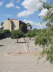 Lineup of curbs & parking meters in a Tucson landscape with trees. (Tim Kiser) Tags: 1960sapartmentbuilding 1960sarchitecture 1960sbuilding 1961 1961architecture 1961building 2015 20151004 arizona arizonalandscape img4657 mainavenue northmainavenue october october2015 pimacounty pimacountyarizona redondotower redondotowerapartments tucson tucsonarizona tucsonlandscape apartmentbuilding building curbs distantbuilding distantpalmtrees downtown downtowntucson landscape ornamentaltrees palmtrees palms parking parkingcurbs parkinglot parkinglotcurbs parkinglotlandscape parkinglotlandscaping parkinglottrees parkingmeters partlycloudy paved pavement rowofparkingmeters southarizona southeastarizona southeasternarizona southernarizona treesinaparkinglot urbanlandscape view unitedstates