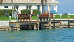 Take a Seat (soniaadammurray - Off) Tags: digitalphotography benches sea seawall dock grass garden ladder man hedge meters house windows roof trees sky benchmonday happybenchmonday