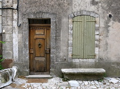 A handsome old façade: Saignon, Vaucluse, Provence (Hunky Punk) Tags: dwwg door shutters saignon vaucluse provence france village stone bench doorway frame green pale