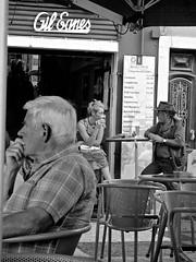 thinking and conversing (tayl0439) Tags: street city urban bw woman white man black men portugal coffee relax women chat fuji drink outdoor think talk social bistro lagos fujifilm gil eanes x10