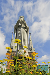 Ave Maria (-clicking-) Tags: flowers sky church statue architecture clouds catholic faith praying vietnam saigon cathedrale queenofpeace notredamesaigon nhthcb vngcungthnhng