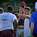 Former NC State quarterback and Seattle Seahawks stand-out Russell Wilson talks to members of the Elon University football team after a workout at Wolfpack practice facility.NS.RussellWilson.6751