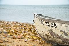 Abandoned Boat (Tim.Regan) Tags: ocean ri light sea lighthouse house seaweed abandoned beach metal island boat sand nikon rocks waves north pebbles rhodeisland shore block washed ashore d7000
