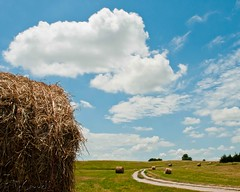 Round Bales (Jim McConnell) Tags: road sky clouds landscape nikon nebraska round hay bales d300s