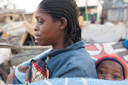 Mother and child at Mongu harbor, Zambia. Photo by Patrick Dugan, 2012.