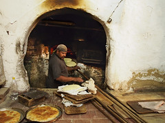 Bread baker (BenDem) Tags: africa wood food cooking work bread fire warm baker african wheat islam traditional fresh unesco business morocco arab fez chef bakery souk medina muslims ethnic moroccan fes freshness baked trational