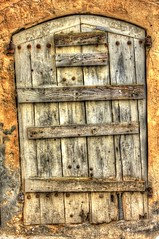 Shut.... (Andy Gant) Tags: france color colour window architecture rust rivets colours wallart oldbuildings textures shutter weathered provence southoffrance languedocroussillon uzes oldoak hww weatheredworn canoneos550d oakshutterrepair