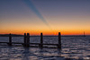 The early bird catches the worm, and I a sunrise (BraCom (Bram)) Tags: shadow cloud holland sunrise canon reflections pier waves glow jetty nederland thenetherlands explore schaduw beacon ouddorp bollards gloed wolk zuidholland goereeoverflakkee spiegeling golven southholland zonsopkomst brouwersdam baken meerpalen canonef24105mm bracom springersdiep canoneos5dmkiii bramvanbroekhoven