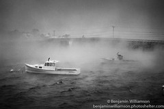 The Storm (BenjaminMWilliamson) Tags: bridge winter blackandwhite snow storm art me landscape boats photography photo scenery view image maine scenic newengland dramatic gifts photograph prints striking blizzard cooks seasmoke lobsterboats cribstone cookslobsterhouse garrisoncove