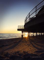 Worthing - Shadows & Curves (Bruus UK) Tags: winter light sunset sea sky storm beach architecture sussex coast worthing marine waves shadows pentax curves shingle calm damage channel