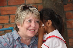 """Whispering her ABCs in English to Chris at Kids Club Phnom Penh <a style=""""margin-left:10px; font-size:0.8em;"""" href=""""http://www.flickr.com/photos/46768627@N07/13295865734/"""" target=""""_blank"""">@flickr</a>"""