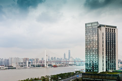 Shanghai Intercontinental (Vaderism) Tags: china city travel bridge roof summer vacation sky house tower tourism rooftop horizontal skyline architecture clouds marina skyscape outdoors photography hotel harbor asia day shanghai citylife landmark panoramic symmetry backgrounds copyspace success vacations intercontinental concepts thebund huangpuriver urbanscene traveldestinations colorimage famousplace peopletraveling