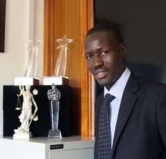 Ugandan lawyer Gerald Abila is the founder of the award-winning Barefoot Law, a tech-savvy non-profit that uses Facebook, Skype, Twitter, SMS, radio and television partnerships to improve access to justice and the law. Credit: Amy Fallon/IPS (IPS Inter Press Service) Tags: africa amy gerald barefoot law fallon lawyer abila