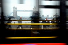 Rush Hour Commute (A-Lister Photography) Tags: city travel motion bus london rain weather horizontal skyline speed umbrella towerbridge londonbridge landscape citylife business commuting rushhour raining greysky commuters cityoflondon londonbus businessmen londontransport realpeople adamlister nikond5100 alisterphotography