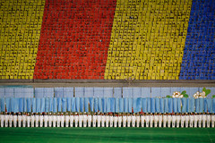 Flag bearers and people pixels (Lil [Kristen Elsby]) Tags: travel asia stadium performance korea multiples editorial performers topv3333 northkorea pyongyang eastasia dprk travelphotography arirang flagbearers canon70200f28l pixelpeople canon7020028l democraticpeoplesrepublicofkorea bandsofcolor massgames chosnminjujuiinminkonghwaguk maydaystadium dprofkorea bandsofcolour canon5dmarkii arirangmassgames peoplepixels