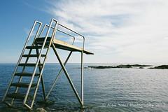 Svaneke Spring (The Old Penfold) Tags: slr film zeiss 35mm denmark iso100 nikon f100 fujifilm analogue bornholm springboard svaneke reala100 25mmf28 zeisszf25mmf28 wildswimming