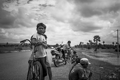 Siem Reap (YuJin Lim) Tags: road kids clouds cambodia flood bikes