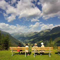 A bench with a view (Bn) Tags: road family flowers blue wild summer sky mountains alps green car pine fauna bench