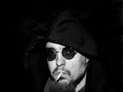 Dark sun glasses (adam_moralee) Tags: bear shadow portrait bw sun white selfportrait man black male adam up night self hair glasses blackwhite hoodie darkness nightshot cigarette smoke wb retro smoking explore hoody finepix hood roll fujifilm facialhair cigarettes facial rolly rollup selfy selfie hooded selfi s1500 moralee adammoralee